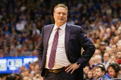 Coach Bill Self looks at the Kansas bench after a play in Allen Fieldhouse