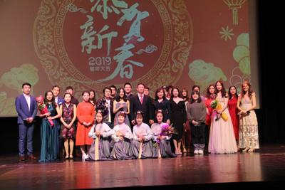 A group gathers on stage at a Lunar New Year's celebration