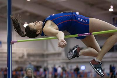 Junior high jumper Adia Eberle jumps over the high bar as she competes in the Bob Timmons Challenge