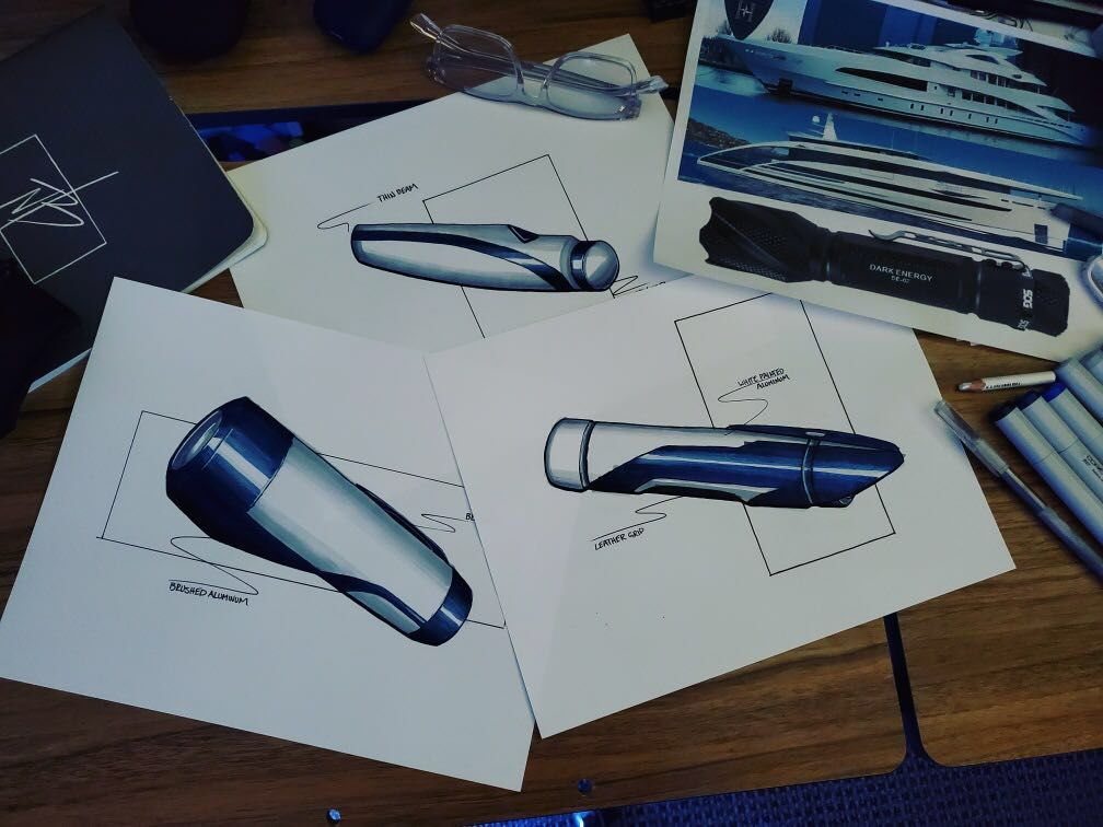 A piece of paper includes three sketches of an aluminum flashlight drawn in ink