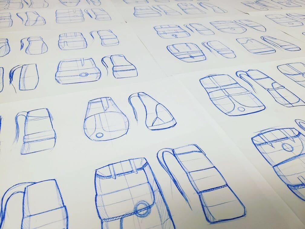 A piece of paper includes sketches of cups draw in ink