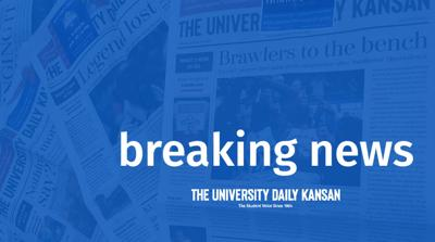 Faded newspapers set the backdrop behind the words 'breaking news' and The University Daily Kansan nameplate (copy)