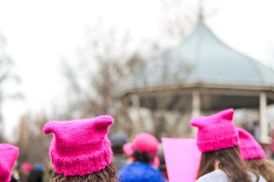 Women don hats resembling cat ears at the Women's March in South Park in 2018.