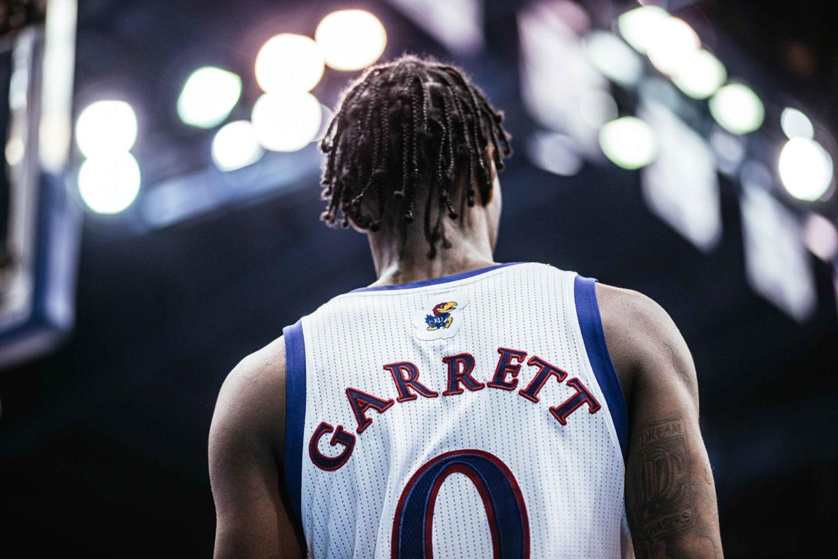 Junior guard Marcus Garrett looks at the court as he stands in Allen Fieldhouse