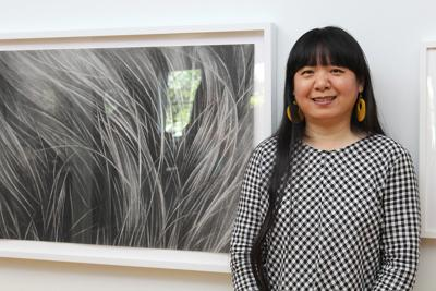 Day in the Life: Lawrence artist Hong Zhang's art explores hair and
