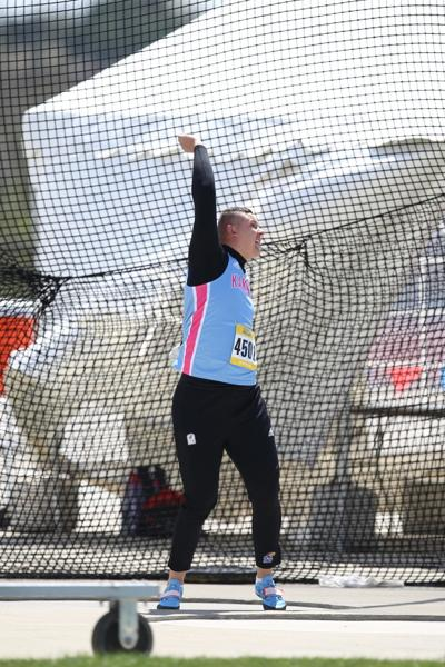 Gleb Dudarev swings his arm up as he finishes the hammer throw at the 2019 Kansas Relays