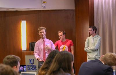 Grant Daily, Student Senate's government relations director, stands as he speaks in front of the senate body