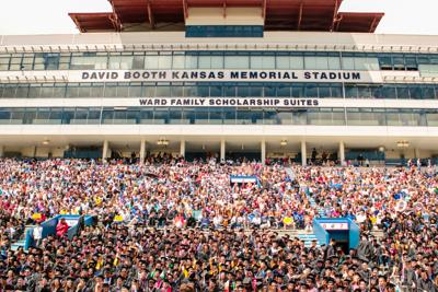 Crowds fill the stands at David Booth Kansas Memorial Stadium during the 2019 commencement ceremony