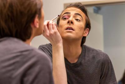 Sophomore Derek Dunn practices his makeup in the mirror (copy)