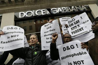31244311d122 ... a banner during a demonstration held by The Out and Proud Diamond Group  and the Peter Tatchell Foundation, outside the Dolce & Gabbana store, in  London, ...