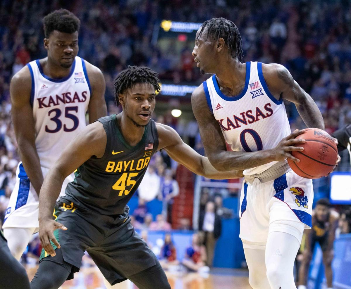 Udoka Azubuike stands on the left behind a Baylor guard while Marcus Garrett waits for a pick on the right.