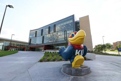 A Jayhawk statue stands outside the Burge Union and Gray-Little Hall