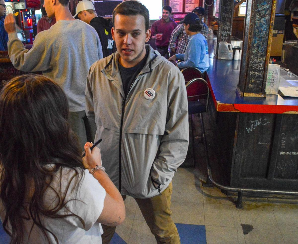 A U.D.K. reporter interviews Zach Thomason inside The Wheel as Crimson and Blue members await election results.