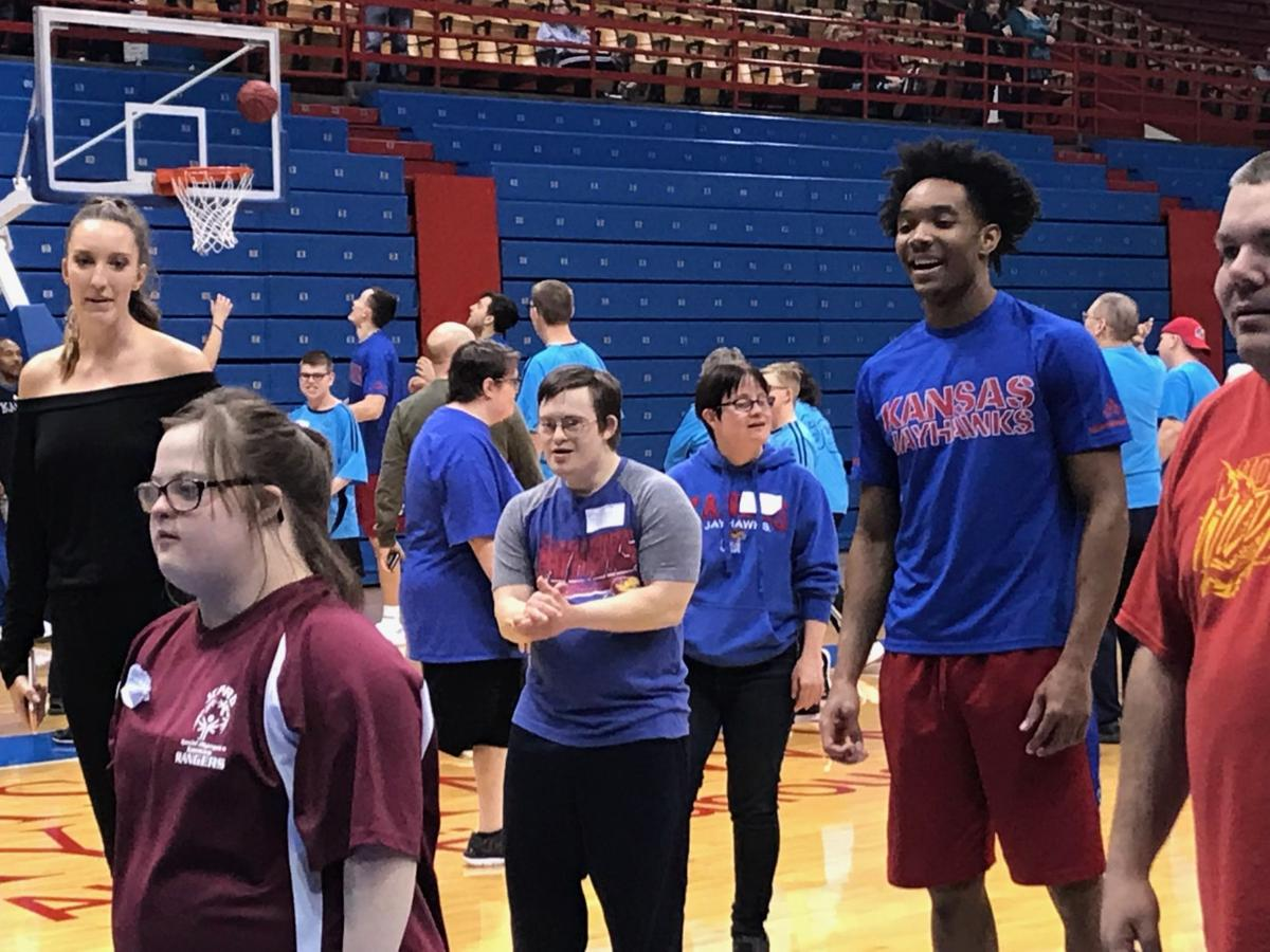 88002015f1b8 Devonte Graham special olympics. Senior guard Devonte  Graham cheers as an  Olympian makes a basket at the 34th annual Wilt Chamberlain ...