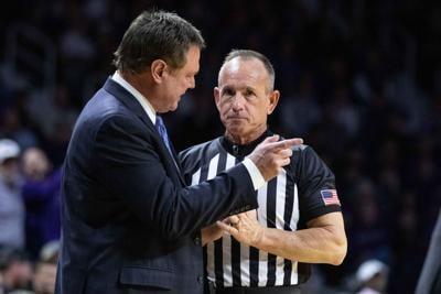 Bill Self speaks with a referee in Bramlage Coliseum