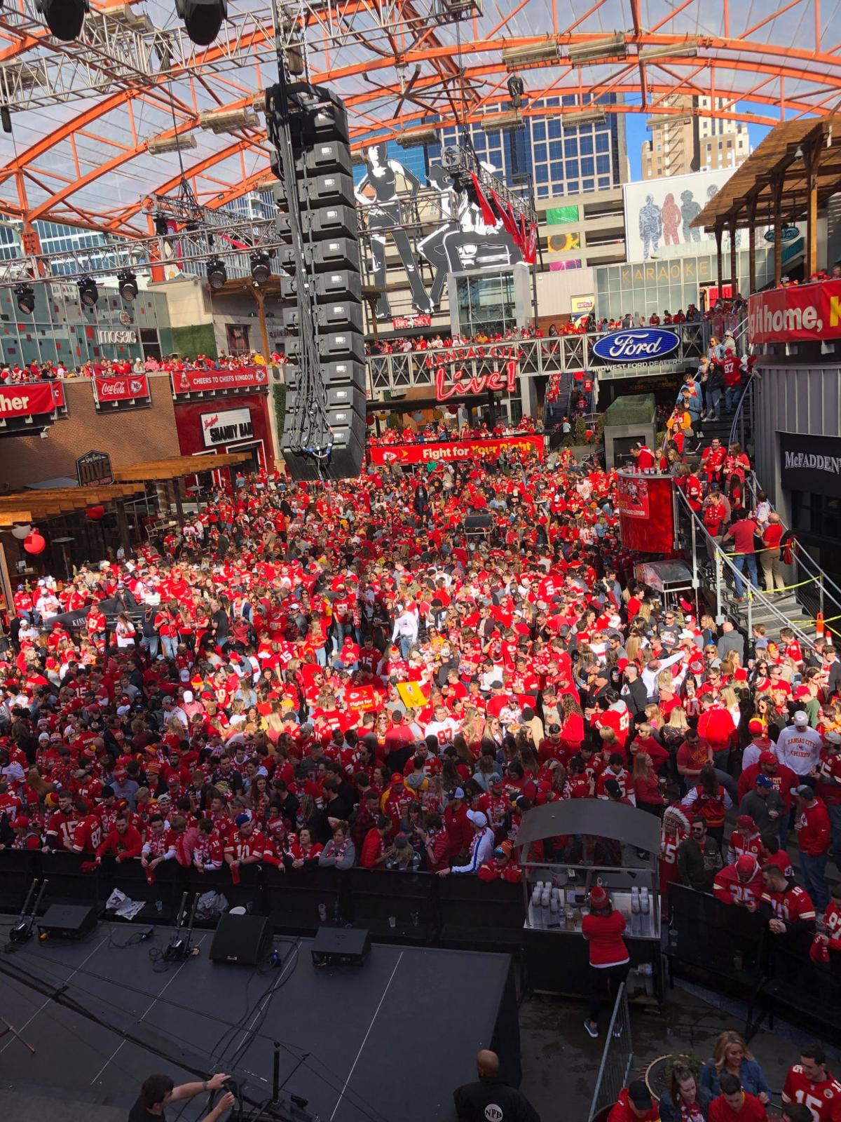 A sea of fans sporting Kansas City Chiefs apparel flood the Power and Light district in Kansas City
