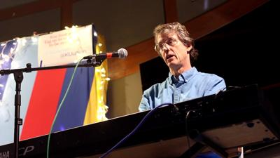 Lawrence songwriter Michael Paull plays piano at the Singer-Songwriter Showcase