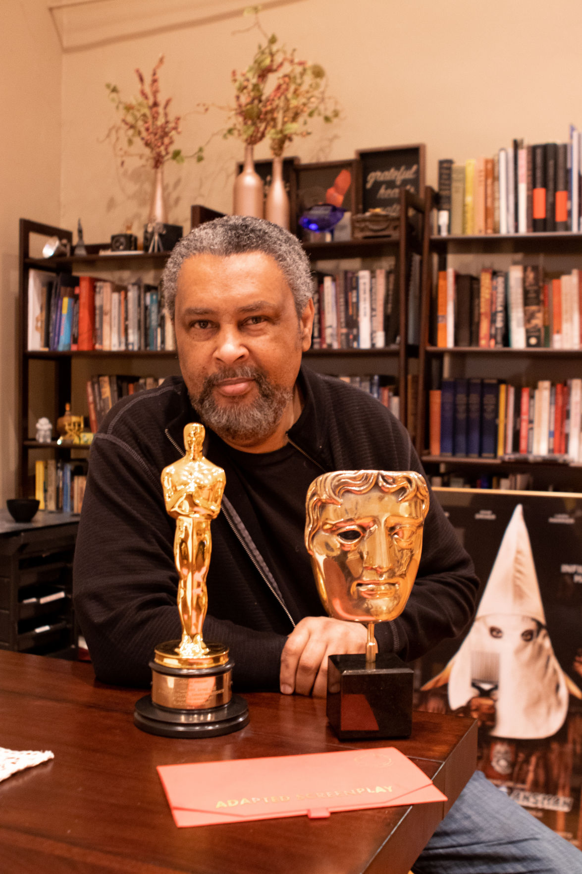 Kevin Willmott sits with his Oscar for Best Adapted Screenplay on his desk