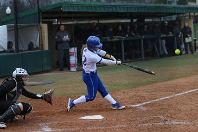 Shelby Hughston swings at home plate