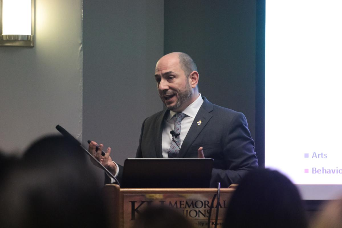 Interim Provost Carl Lejuez speaks at a lectern in the Kansas Union