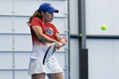 Vasiliki Karvouni pushes the racket away from her as she goes to hit the ball in front of her (copy)