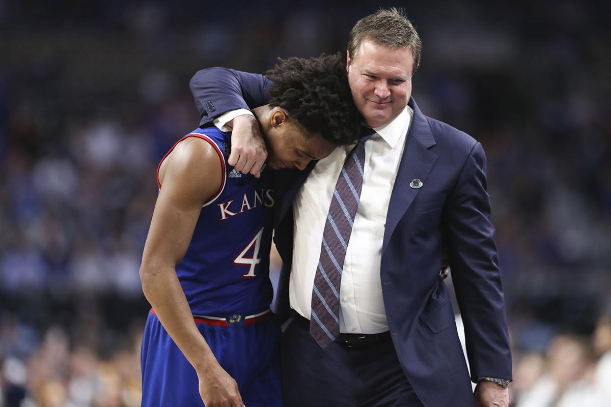 cdb379825c6 Men's basketball vs. Villanova 33.jpg. Kansas coach Bill Self hugs senior  guard Devonte' Graham ...