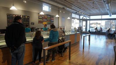 Customers wait in line inside the new Sylas and Maddy's ice cream shop.
