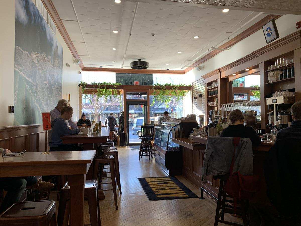 People sit at tables and study inside the Alchemy Coffee and Bake House