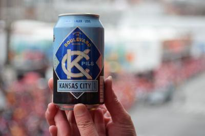 Hands hold up a Boulevard Brewing Co. Kansas City Lager can