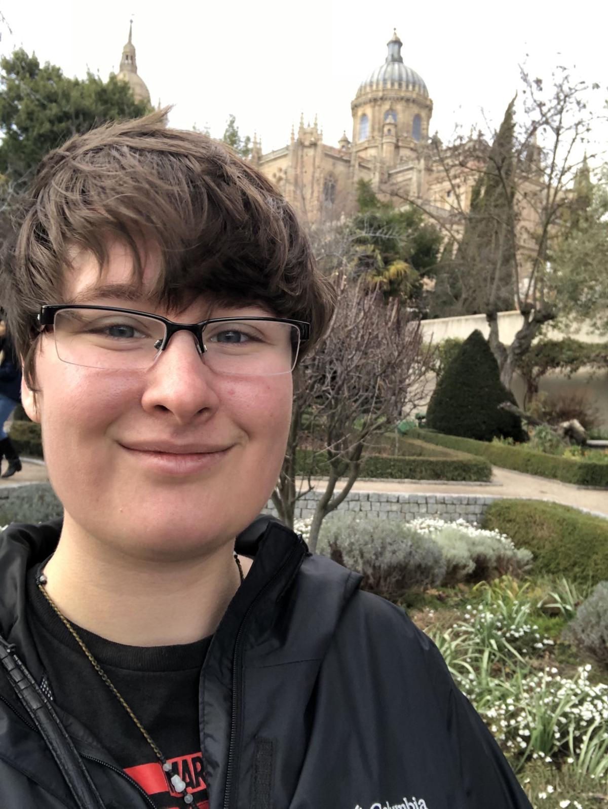 Bea Reiter soft smiles for a selfie in a park in Salamanca