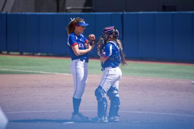Freshman pitcher Lexy Mills and junior catcher Shelby Hughston talk on the softball mound
