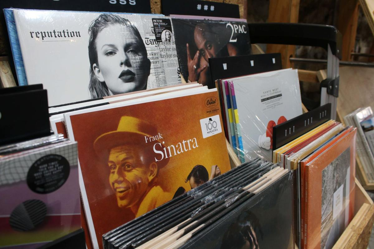 Vinyl album covers line the wooden shelves at Urban Outfitters