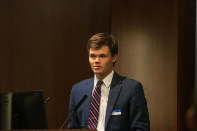 Seth Wingerter speaks at a podium during a Student Senate meeting