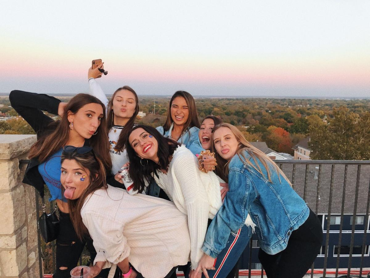 A group of girls pose together on the roof of the Oread hotel