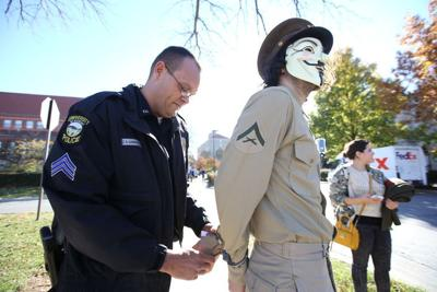 Two men in masks arrested on campus