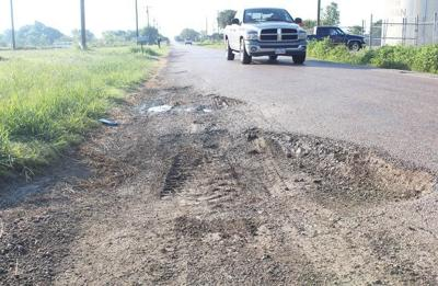 Commissioners clash on county road management system