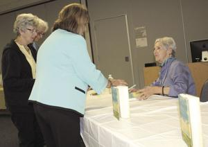 "<p><span>The Kaufman Herald/PHIL MAJOR</span></p><p><span>Paulette Jiles, right, signs copies of her latest book, ""News of the World,"" during Thursday's annual Friends of the Kaufman County Library's Book and Author Luncheon.</span></p><p><span> </span></p>"
