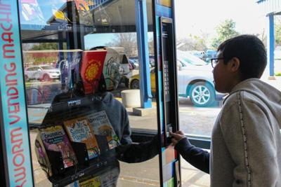 Students at Phillips Elementary choose books from new vending machine