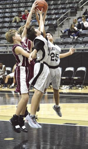 Junior high hoops teams find victories hard to come by