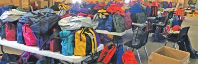 Local organizations provide school supplies to children