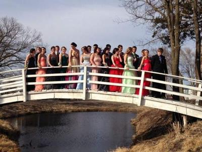 Posing for a photo on a footbridge near Pierce