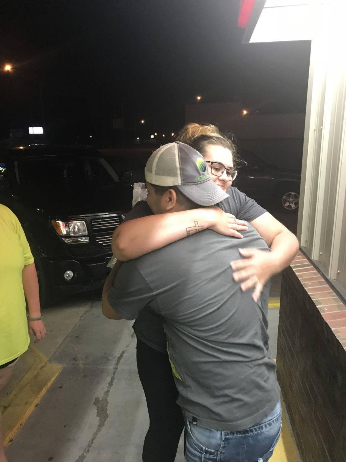 Family members reunited as some workers detained in federal immigration raid return to O'Neill