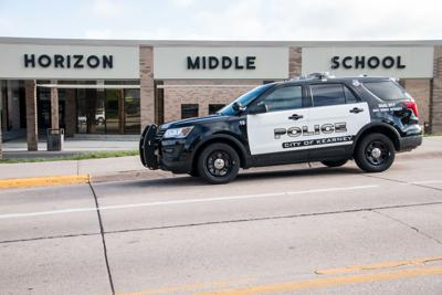 Horizon Middle School with cop car