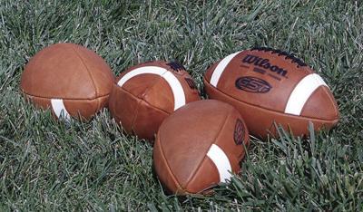 Four footballs
