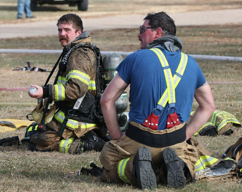 Kearney Volunteer Firefighters Sam Sutherland and Max Gintlzer