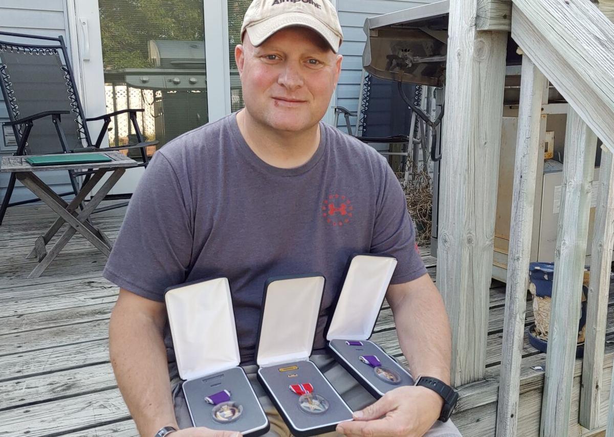 Johnny Eynetich - medals