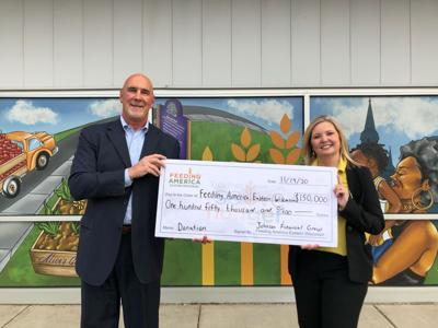 Johnson Financial Group CEO Jim Popp presents $150,000 donation to Feed America