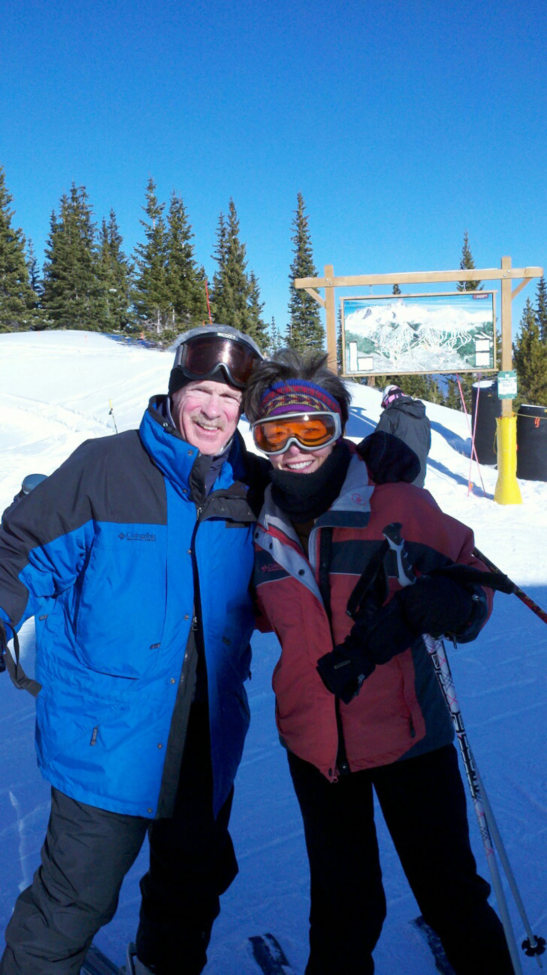 Dr. Carroll and wife skiiing