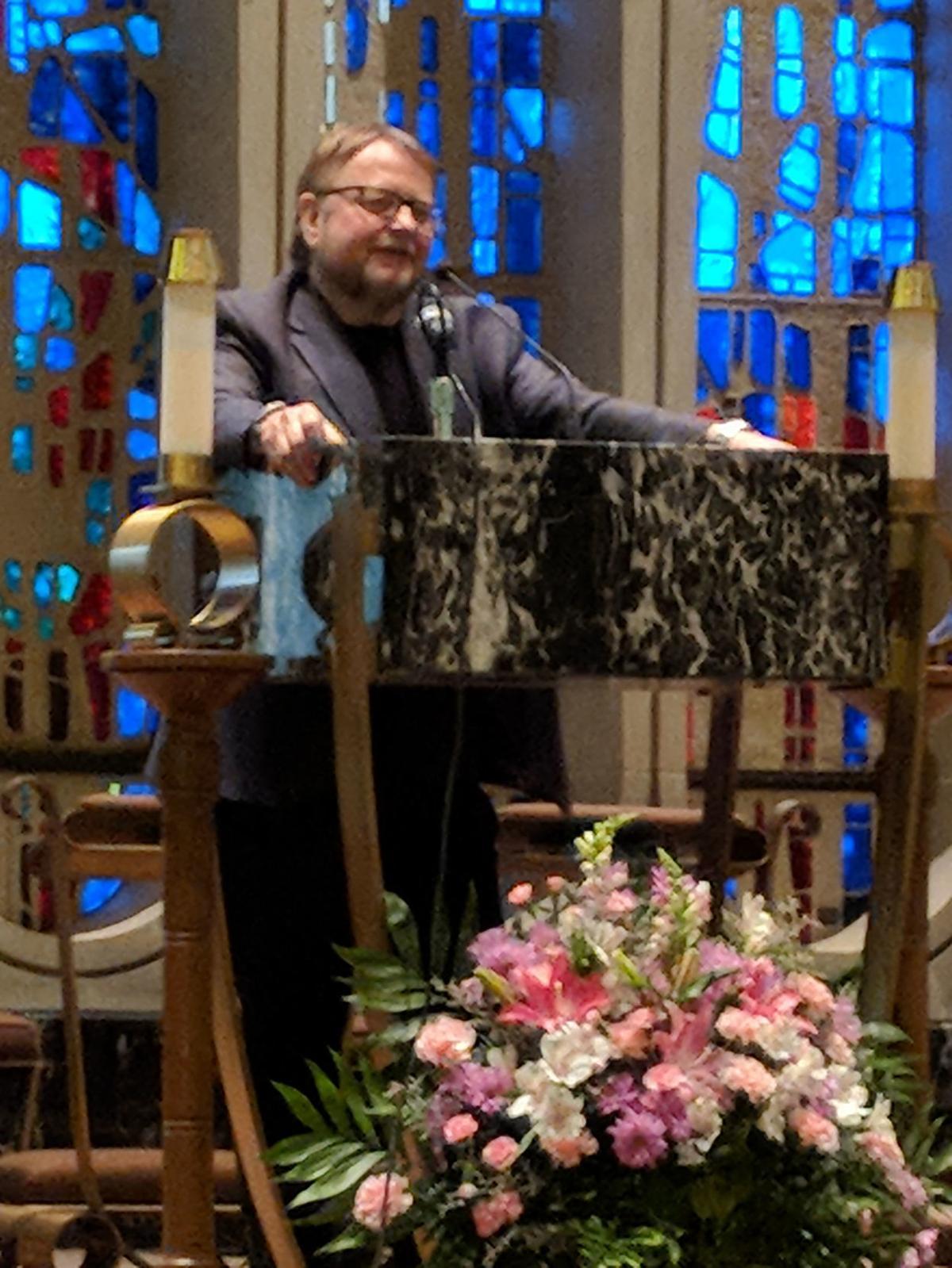 Author Luis Alberto Urrea in church