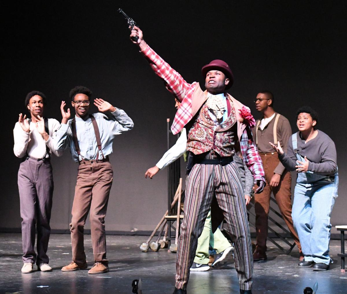 Scottsboro Boys cast on stage with gun